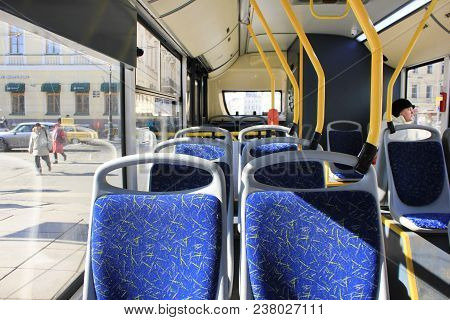 St. Petersburg, Russia - March 28, 2018: Bus Interior With Empty Seats On Sunny Day. Public Transpor