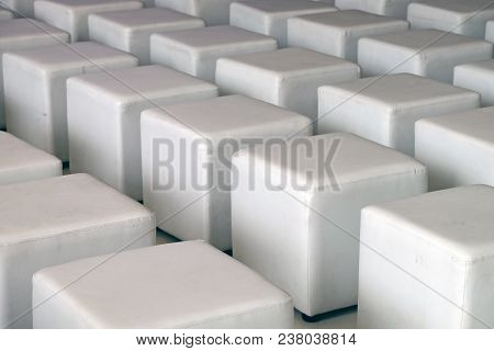 Rows Of White Square Box Shape Leather Chairs