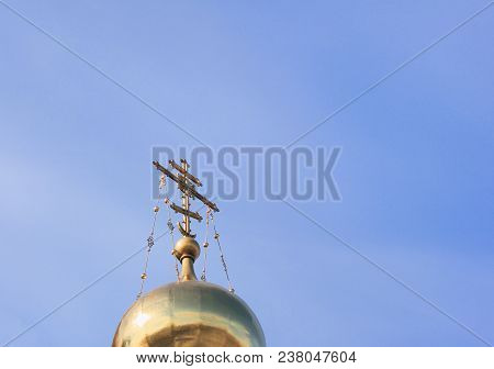 Christian Orthodox Church Exterior With Cross And Golden Dome On Empty Blue Sky Background. Top Of R