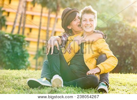 Happy Girlfriends In Love Sharing Time Together At Travel Trip Hugging At Garden - Playful Women Fri
