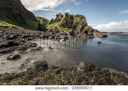A View Of Dunluce Castle Ruins In County Antrim.
