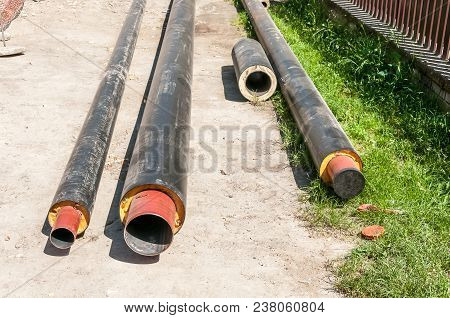 Close Up Of New Insulated Pipes For Water District Heating Sewage Or Gas With Insulation On The Pipe
