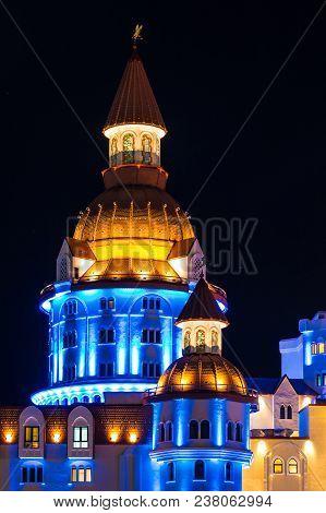 Adler, Sochi, Russia - December 9, 2017: Night Illuminated Part Of The Facade Of Bogatyr Hotel In Th