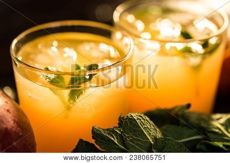 Jars With Various Cold-pressed Raw Tropical Fruit Juice Or Smoothie. Pineapple, Mango And Orange Mix