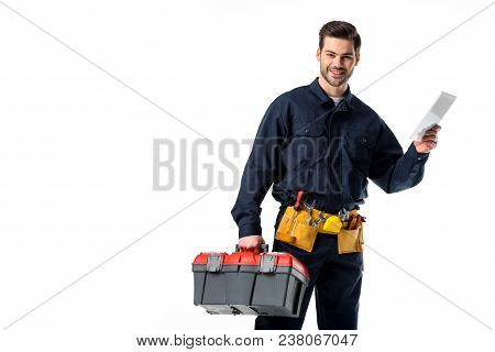 Portrait Of Smiling Plumber In Uniform With Tool Box And Digital Tablet Isolated On White