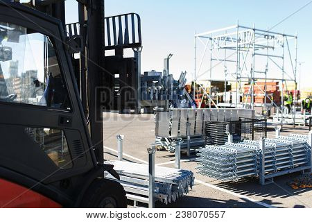 Modern Electric Forklift Carries Special Metal Structures For The Construction And Erection Works. O