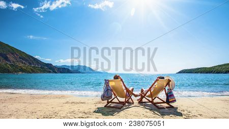 Happy couple relaxing on the beach. Summer vacation
