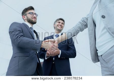 Handshake of business partners before the talks.