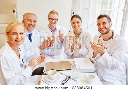 Successful doctors applauding as a team