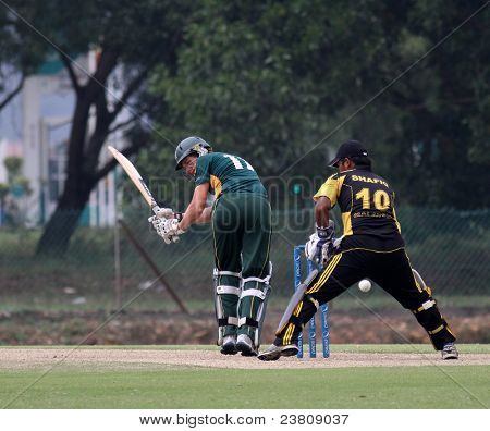 PUCHONG, MALAYSIA - SEPT 24: Malaysia's Mohd Safiq (10) watches Guernsey's Ben Ferbrache hits at the Pepsi ICC World Cricket League Div 6 finals in Kinrara Oval on Sept 24, 2011 in Puchong, Malaysia.