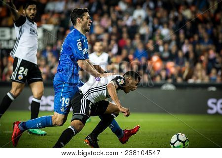 VALENCIA, SPAIN - APRIL 18: (L) Molina, Murillo during Spanish La Liga match between Valencia CF and Getafe CF at Mestalla Stadium on April 18, 2018 in Valencia, Spain