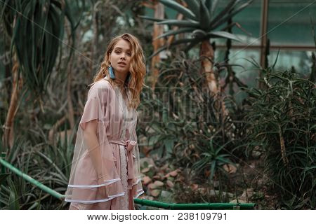 Young Sexy Girl Wearing Sleepwear Walking In Cactus Garden.