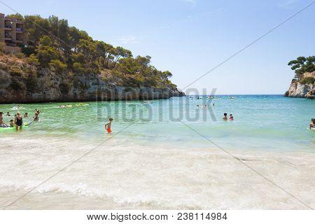 Cala Santanyi, Mallorca, Spain - August 2016 - Tourist At The Beach Of Santanyi Enjoying Their Leisu