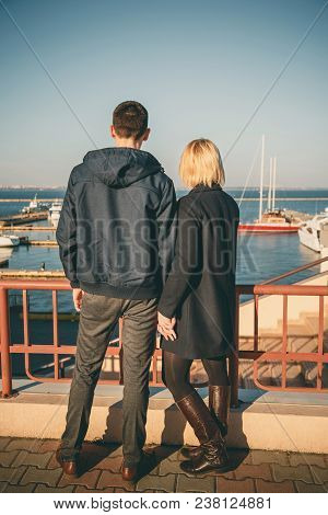 Happy Romantic Attractive Young Couple Staying Together At The Pier, Port Outside.
