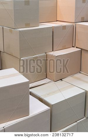 Piles Or Stacks Of Paper Boxes With Goods In Storage. Cardboard Boxes.