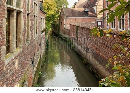 Old Historic Canal In Groot Begijnhof Of Leuven. Is A Well Preserved Beguinage And Completely Restor