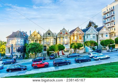 San Francisco, Apr 1, 2018: Late Afternoon Sun Light Up A Row Of Colorful Victorian Houses Known As