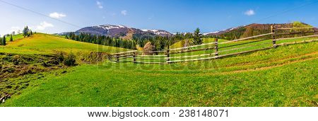 Panorama Of Mountainous Rural Area. Fence Along The Path On A Grassy Hill. Beautiful Landscape With
