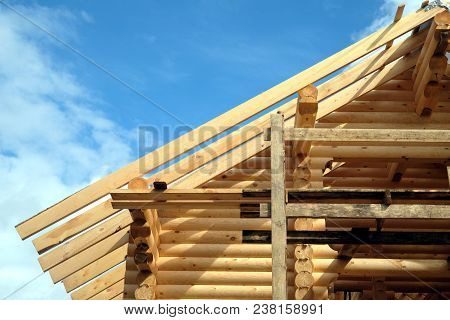 Process Of Wooden House Straight Roof Slope Mounting Front View. Wooden Country House Construction