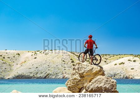 Mountain Biker Looking At View And Traveling On Bike In Summer Sea Landscape. Man Riding A Bicycle I