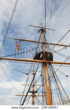 Tall Mast On Old Ship With Rigging