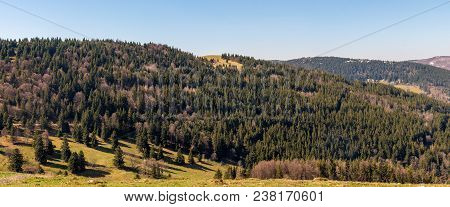 French Landscape - Vosges. Panoramic View Of A Small Village In The Vosges With Snow Covered Mountai