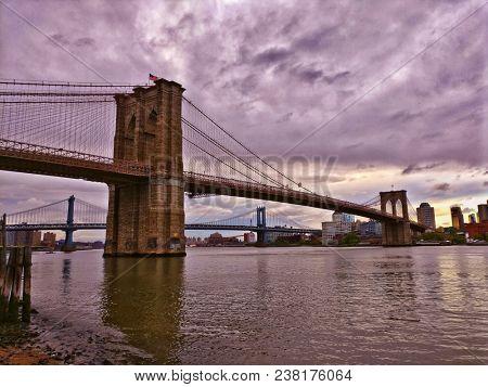Brooklyn Bridge in new york city with dramatic sky