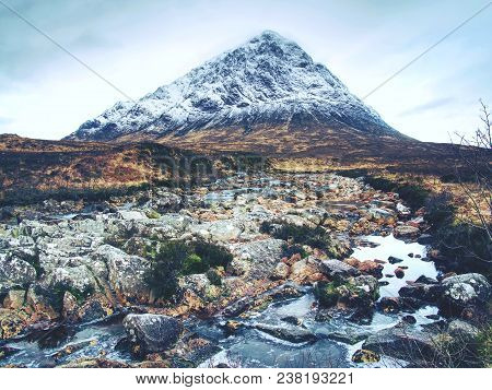 The Stob Dearg Peak Of Buachaille Etive Mor At The Entrance To Glen Coe. Scottish Highlands In Early