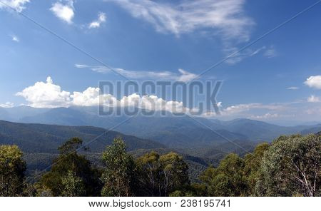 Broad Panorama Of The Countryside In New South Wales With Mountains. View From Snowy Surge Tower On