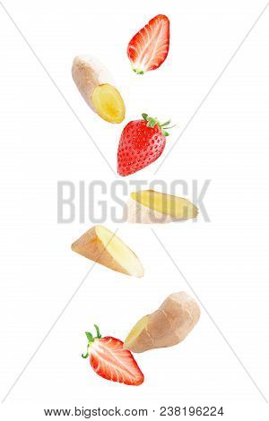 Isolated Falling Fruits. Flying Sweet Strawberry And Ginger Isolated On White Background With Clippi