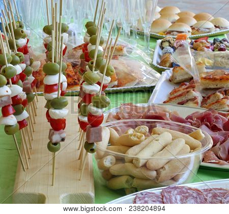 Italian Caprese Skewers With Tomato Mozzarella Green Olives And More Foods Like Sandwiches And Salam