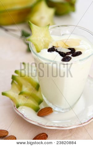 Healthy breakfast [yogurt with almond and starfruit ]