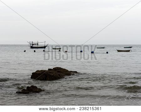 Scenery View In Ban Krut, Prachuap Khiri Khan With Beach, Sea, Sky, And Fishing Boat, Which Is Famou