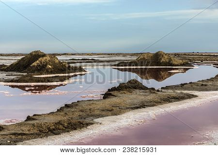 Red Salt lake at Salin de Aigues-Mortes in the Camarque, France poster