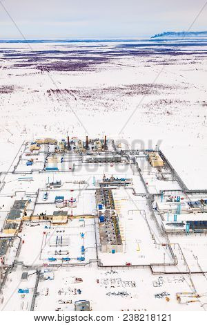 Oil And Gas Industry. Oil Pump Jack Station In A Oil Field In Tundra. Petrochemical Object In West S