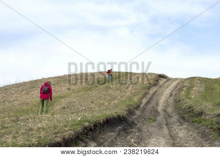 People Climb On Foot Uphill, Dirt Road To The Top Of The Mountain, Hill