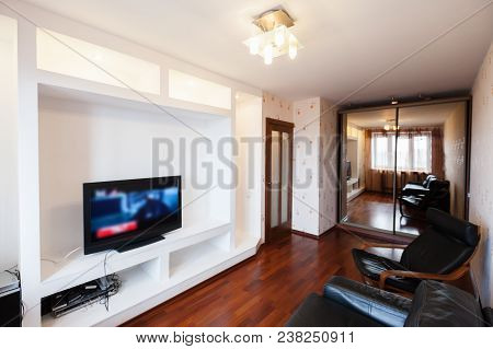 Empty Living Room Interior With Black Leather Chair, Sofa And Tv