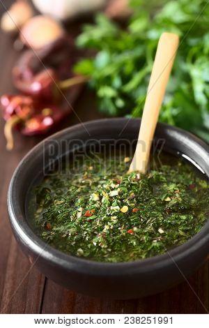 Raw Homemade Argentinian Green Chimichurri Or Chimmichurri Salsa Or Sauce Made Of Parsley, Garlic, O