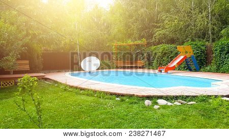 Pool In The Backyard With A Slide. Holiday House With Swimming Pool. Resort House