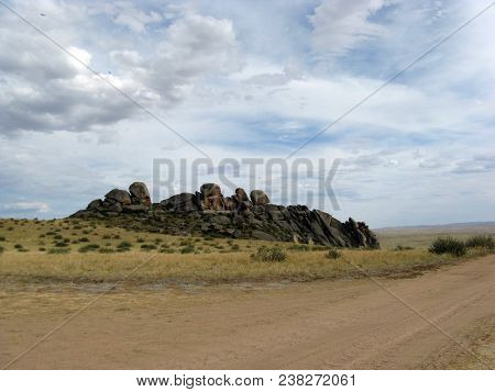 Wide Steppe With Yellow Grass Under A Blue Sky With White Clouds Sayan Mountains Siberia Russia
