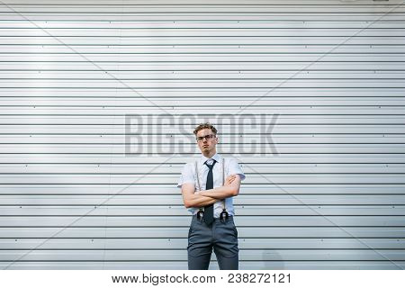 Serious Confident Purposeful Motivated Ambitious Young Stylish Hipster Business Man With Crossed Arm