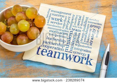teamwork word cloud on a nap[kin with fresh grapes