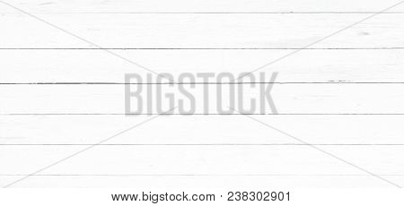 wood texture background, light oak of weathered distressed rustic wooden with faded varnish paint showing woodgrain texture. hardwood white planks pattern table top view poster