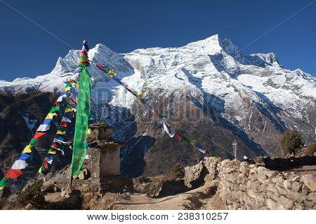 Panoramic View Of Kangtega And Thamserku Peaks And Ancient Stone Chorten Above Namche Bazaar In Saga