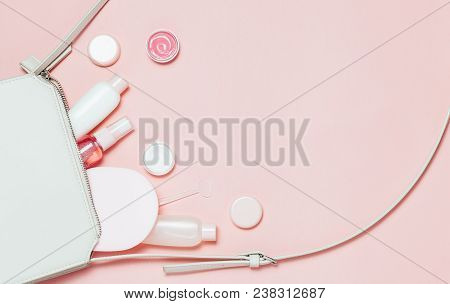 Beautiful Decorative Cosmetic And Creams Set From Cosmetic Bag On Pink Background. Copyspace For You