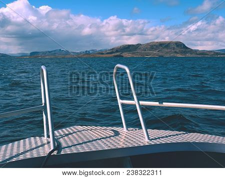 Midday Boating In Blue Sea. Close View From Boat Bow Metal Deck. Metal Handrail On The Edge Of The D