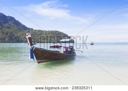 Traditional Thai Longtail Boat On Emerald Sea At  Andaman Sea