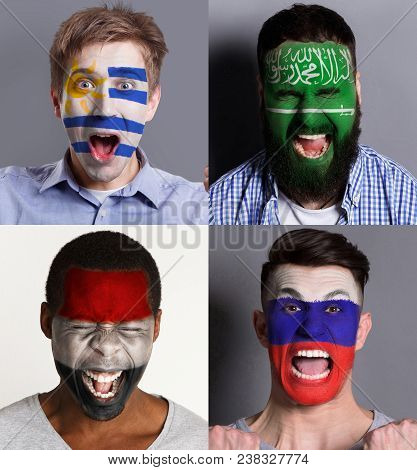Emotional Soccer Fans With Painted Flags Of Russia, Saudi Arabia, Egypt And Uruguay On Faces. Rooter
