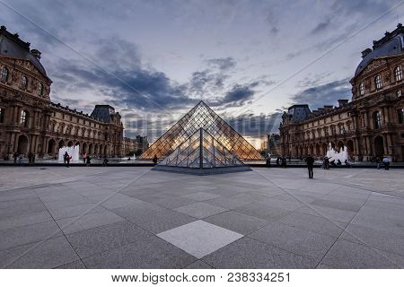 Paris, France - August 8, 2017. Grand Louvre Pyramid At Dusk. The View On The Main Courtyard Of Muse
