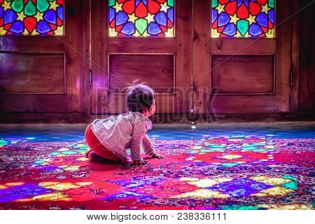 Shiraz, Iran - October 23, 2016: Iranian Baby In Nasir Ol Molk Mosque Also Known As Pink Mosque In S